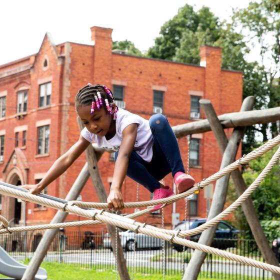 child on playground equipment