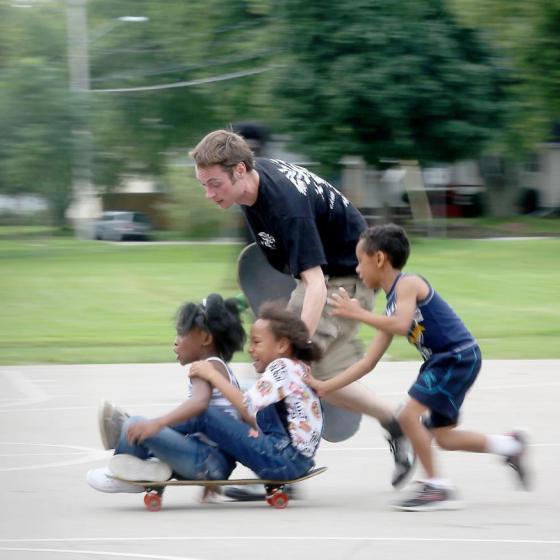 kids on a skateboard in Madison, WI park;